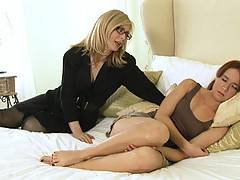 Nina Hartley and Annabelle Lee lick and spank to get off.