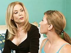 Lesbian babes Nina Hartley and Ariel X play with each other in this erotic sex scene