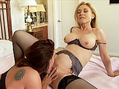 Smokin' hot blonde Nina Hartley gets pussy licked by busty Rachel Steele